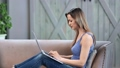 Focused young freelancer woman working remotely use laptop. Medium shot on RED camera 65450918