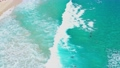 Aerial drone shot follows bright tropical wave as bodyboarder rides toward shore 65452829