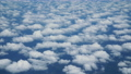 Aerial view above clouds from airplane window. 65495957