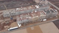 FullHD Aerial view of working Construction site Large construction site including several cranes working on a building area pan view 65559643