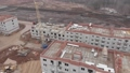 Aerial view of cranes working on a large contruction site 65559644
