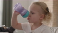 Little child drinking milk from the bottle 65601463