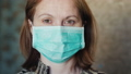Portrait of a young woman in a medical mask. The quarantine concept 65635182