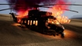 burned military helicopter in the desert at sunset 65673984