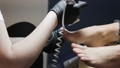 The legs of a young woman receive pedicures in a spa salon. 65814325