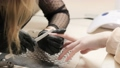 Master does manicure on female hands. 65814330