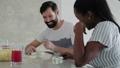 3 Happy Interracial Couple Having Fun Playing Domino At Home 65850747