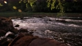 Picturesque 4K video of river cascades at evening with stone and may flies above water surface 65919242
