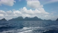View from deck of boat ferry traveling from Coron to El Nido overlooking green mountain islands and deep blue ocean water waves from boat. 30fps realtime UHD video H.264 66011426