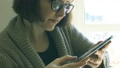 Caucasian woman with glasses using tablet 66089634