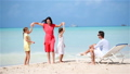 Young family on vacation have a lot of fun. Mother dancing on the beach with her beautiful kids 66160857