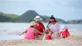 Parents with kids play making sand castle at tropical white beach 66160866