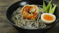 Soba Noodles with Shrimps served Boiled Egg in shoyu soy sauce Soup Japanese Food Fusion Style sprinkle white sesame and seaweed decorate leek sideview 66398944