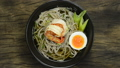 Soba Noodles with Shrimps served Boiled Egg in shoyu soy sauce Soup Japanese Food Fusion Style sprinkle white sesame and seaweed decorate leek topview 66398945
