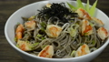 Soba Noodles with Shrimps and shoyu soy sauce Japanese Food Fusion Style sprinkle white sesame and seaweed decorate leek sideview 66398947