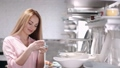 The pretty housewife is choosing china crockery at the kitchen ware store 66406011