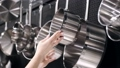 The beautiful woman is checking the stainless steel tableware 66406014