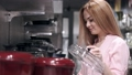 The pretty woman is choosing a pan in a tableware store 66406017
