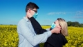 Pandemic is over. Guy and girl take off medical masks from each other. 66415700