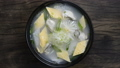 Oysters Soup with egg and radish Korean Food Style (Gulguk) refreashingly clear dish decorate with leek topview 66419176