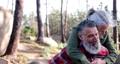 Close up senior woman piggyback senior man at forest 66448044