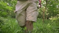 front view of walking man's legs in shorts, rush in jungle forest 66517596