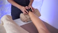 back massage and therapy with hot stones 66525504
