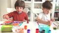 Kid Painting at Kindergarten 66581160