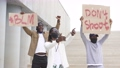 Group of young protesting male holding piece of cardboard with text - don't shoot 66830753