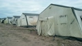 old soldiers canvas tents torn in the wind in the field 66878115