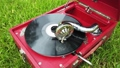 playing an old retro gramophone 66878116