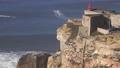 Lighthouse on coast of Atlantic ocean in Nazare 66921565