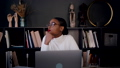 Self isolation. Portrait of beautiful young thoughtful African woman working online from home using laptop slow motion. 66927648