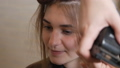 hair polishing procedure. The hairdresser at home during the period of the virus, self-isolation polishes the hair using a special machine for polishing hair. cut off split ends 67038370