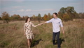 Young Couple in Love Holding Hands Together in Forest. 67156920