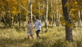 Young Couple in Love walking on Meadow in Summer - Togetherness Concept. 67156956