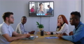 Creative business colleagues in video conference in meeting room in modern office 67397238
