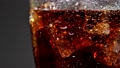 carbonated drink Cola in a glass glass with ice 67431525