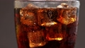 carbonated drink Cola in a glass glass with ice 67529670