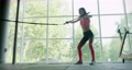 Beautiful young woman does training with weighted bar in gym. Attractive Female training 67529791