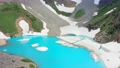 Turquoise glacial Lake in big snowy mountains. Aerial view 4K 67707582