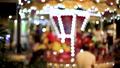 Blur kid playing on Carousel and bokeh of light at night. 67723561