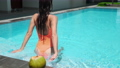 relax in swimming pool at hot day 67787026