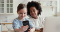 Overjoyed small diverse kids making selfie on smartphone. 67817373