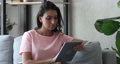 Indian woman spend free time using tablet electronic modern device 67885978