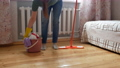 The cleaning lady takes a mop and a bucket and leaves. 67927140