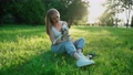 Happy young woman petting french bulldog outdoors. 67957576