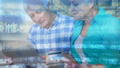 Animation of white and blue data processing over senior Caucasian couple holding a credit card 67986155