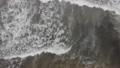 Aerial Footage of waves full of algae and dark water after inflow. 68323543