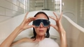 Masked woman dives into the bathtube 68448815